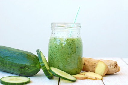 Healthy fresh superfood smoothie drink from gree cucumber and ginger, front horizontal view